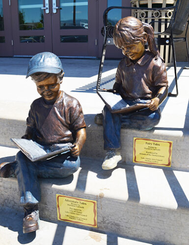 Sculpture of Boy and Girl Reading